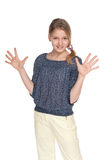 Preteen girl makes a hands gesture Stock Photography