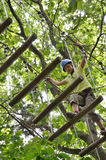 Preteen girl at the obstacle course Royalty Free Stock Photo