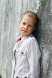 Preteen girl near the stone wall. Royalty Free Stock Image