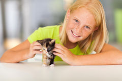 Preteen girl pet. Lovely pre teen girl with pet kitten at home Stock Photo