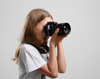 Preteen girl photographing Stock Image