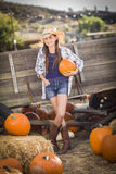 Preteen Girl Portrait at the Pumpkin Patch Royalty Free Stock Photo