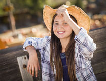Preteen Girl Portrait at the Pumpkin Patch Stock Photo