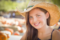 Preteen Girl Portrait Wearing Cowboy Hat at Pumpkin Patch Royalty Free Stock Images