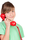 Preteen girl with red telephone Stock Photos