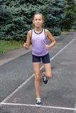 Preteen girl running Stock Photography