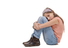 Preteen girl sad  is sitting on the floor Royalty Free Stock Images