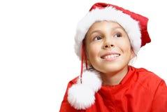 Preteen girl in Santa's hat Stock Photos