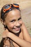 Preteen girl on sea beach. Preteen girl in swiming outfit enjoying sun-bath on sea beach Royalty Free Stock Photography