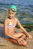 Preteen girl on sea beach. Preteen girl in diving outfit enjoying sun-bath on sea beach Royalty Free Stock Photography