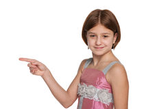 Preteen girl shows her finger to the side Stock Photo