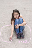 Preteen girl sitting in a circle Royalty Free Stock Images