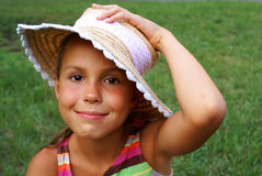 Preteen girl in straw hat Royalty Free Stock Photos