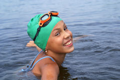 Preteen girl swimming Royalty Free Stock Photo