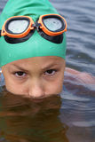 Preteen girl swimming Stock Image