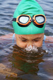 Preteen girl swimming Stock Photo