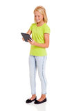 Preteen girl tablet. Cute preteen girl using tablet computer isolated on white Royalty Free Stock Image