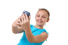 Preteen girl taking self-portrait with mobile phone Stock Photo