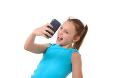 Preteen girl taking self-portrait with mobile phone Stock Photography
