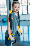 Preteen girl training with resistance bands in fitness class Stock Photos