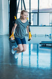 Preteen girl training with resistance bands in fitness class Royalty Free Stock Image