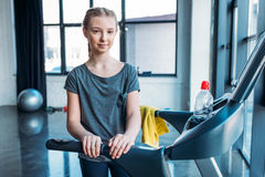 Preteen girl training on treadmill in fitness class Stock Photography