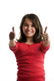 Preteen girl two thumbs up. A preteen girl frontal with big smile and two thumbs up isolated on white background Stock Photography