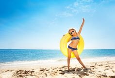 Happy girl enjoying summer vacations at the beach Royalty Free Stock Images
