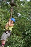Preteen girl zipping down Stock Photos