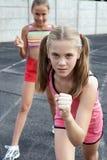 Preteen girls running Stock Images