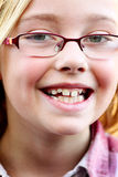 Preteen, Glasses and a Big Smile. A big smile on a little preteen blond cutie 6 year old girl wearing glasses. Shallow depth of field Royalty Free Stock Photo