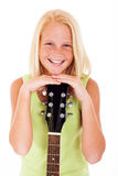Preteen guitarist laughing Stock Photo