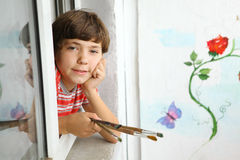 Preteen handsome artist boy with brushes Royalty Free Stock Photo