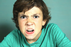 Preteen handsome boy angry close up portrait Stock Photo