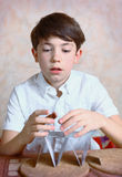 Preteen handsome boy build  card house Stock Image