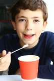Preteen handsome boy with cappuccino paper glass. Enjoy smile the skin skum top taste Stock Photo