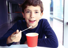 Preteen handsome boy with cappuccino. Paper glass enjoy smile the skin skum top taste Royalty Free Stock Images
