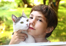 Preteen handsome boy with cat close up photo Stock Photography