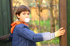 Preteen handsome boy with chewing gum bubble. Close up country portrait Stock Photo
