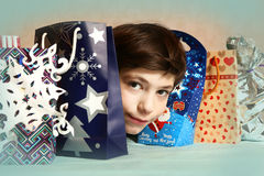 Preteen handsome boy with christmas presents Stock Images