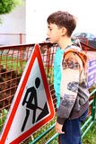 Preteen handsome boy at the construction border with warning sig Stock Images
