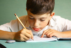 Preteen handsome boy drawing portrait Royalty Free Stock Photography