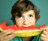 Preteen handsome boy eat water melon Stock Photo