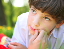 Preteen handsome boy face close up portrait in the summer park Royalty Free Stock Photo