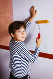 Preteen handsome boy in frock with roll coaster and wallpaper Stock Photo