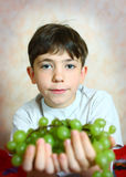 Preteen handsome boy with green grapes close up portrait Royalty Free Stock Photo