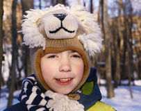Preteen handsome boy in knitted lion hat Stock Image