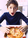 Preteen handsome boy with pizza portrait Royalty Free Stock Photos