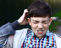 Preteen handsome boy scratch his head Royalty Free Stock Photos