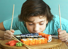 Preteen handsome boy with sushi roll set Stock Image